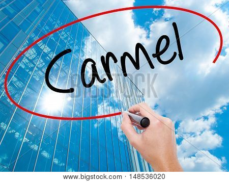Man Hand Writing Carmel With Black Marker On Visual Screen