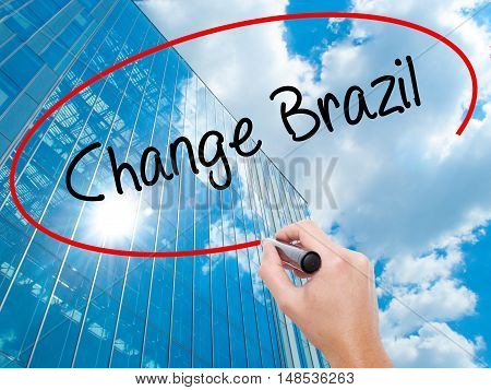 Man Hand Writing Change Brazil  With Black Marker On Visual Screen