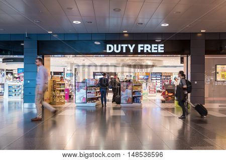 Zurich Switzerland- MAY 14 2016: Many passager shopping in Duty Free shop in International Airport before departure