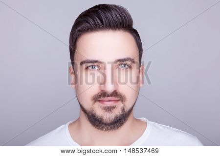 Handsome Smiling Man In Casual Shirt On Gray Background