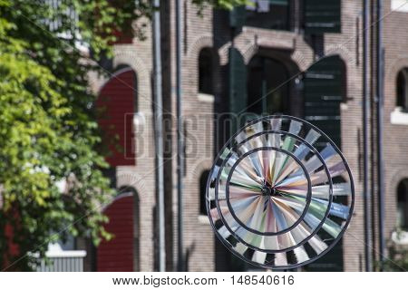One colored vane with old brown house with shutters as background