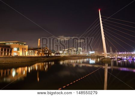 Night time at the River Tawe and the Millennium bridge in Swansea