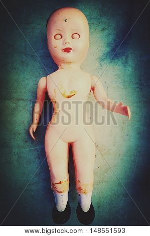 eerie vintage naked celluliod doll with hand risen