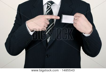Salesman Pointing Out His Nametag