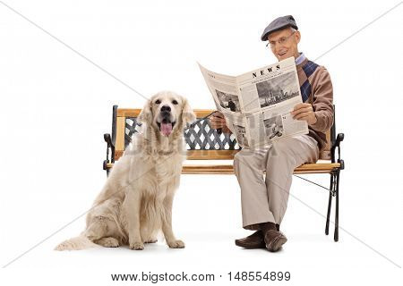 Elderly man sitting on a bench wth his dog and reading a newspaper isolated on white background.