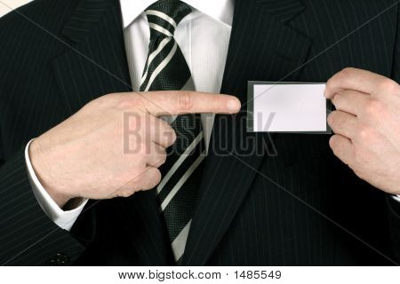 Salesman Pointing To His Nametag