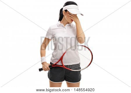 Disappointed female tennis player holding her head in disbelief isolated on white background