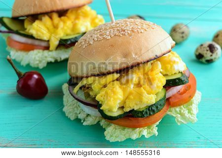 Vegetarian Diet burgers with sweet omelette and vegetables.