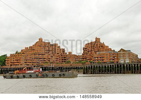 LONDON, ENGLAND - JULY 8, 2016: Free Trade Wharf - a 1980s brick riverside residential complex and an adjoining pair of listed late 18th Century former warehouse buildings in London Borough of Tower Hamlets.