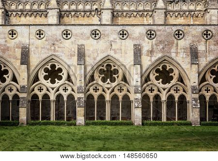 The cloisters of Salisbury Cathedral in Wiltshire, UK. This Anglican Cathedral was built in the 13th Century, and the cloisters are a covered exterior walkway in a quadrangle format.