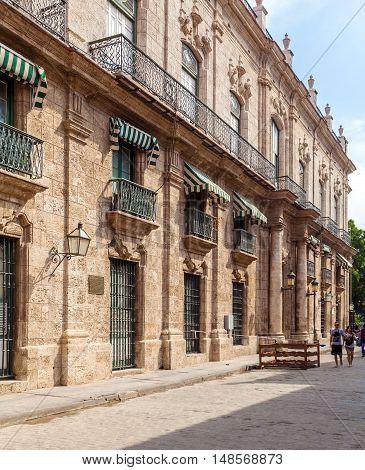 Havana, Cuba - April 1, 2012: Tourists Walk Near Palacio De Los Capitanes