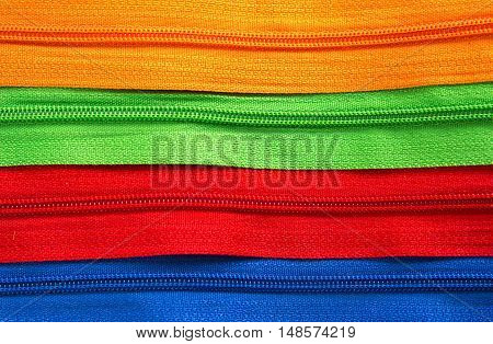 Colorful zipper collection texture background. Colorful Zippers in different colors on white background.