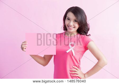Happy Woman with pink ribbon and show empty billboard great for prevention breast cancer concept