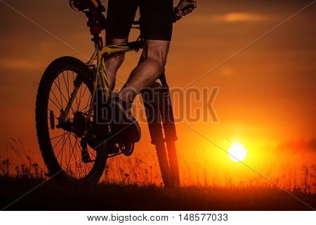 Silhouette Of A Bike On Sky Background