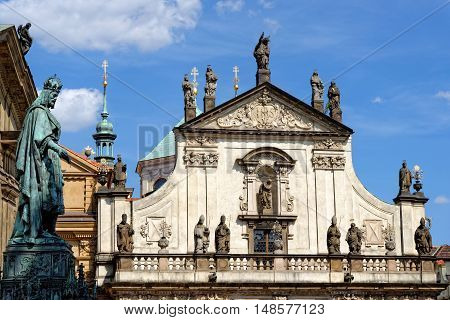 St. Savior (St. Salvador) church at Karlova street in the Old town part of the Clementinum and the statue of Charles IV. The church is one of the most precious early Baroque monuments in Prague. poster