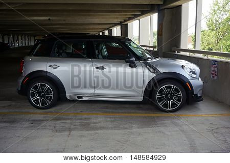 JOLIET, ILLINOIS / UNITED STATES - SEPTEMBER 4, 2016: A Mini Cooper S car is parked in the parking garage of the Presence Saint Joseph Medical Center in Joliet.