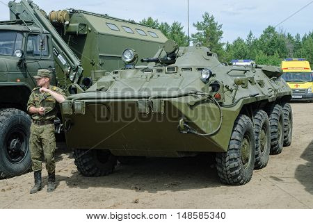 Tyumen, Russia - June 11, 2016: Race of Heroes project on ground of the highest military school. Cadet of Tyumen highest military and engineering command school near armored transporter