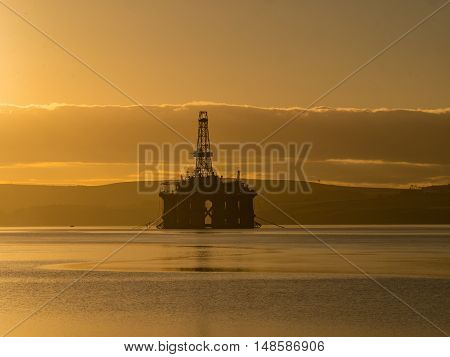 Stacked Semi Submersible Oil Rig at Cromarty Firth in Invergordon Scotland UK- Many offshore drilling rig parked and waiting for drilling work offshore North Sea