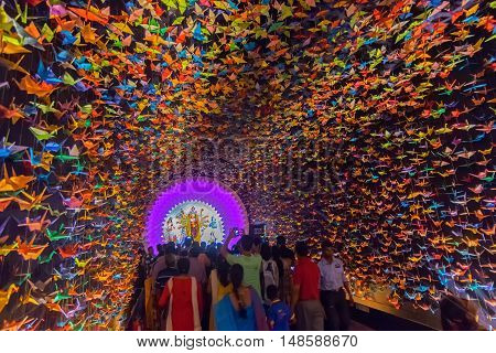 KOLKATA INDIA - OCTOBER 18 2015 : Night image of decorated Durga Puja pandal shot at colored light at Kolkata West Bengal India. Durga Puja is biggest religious festival of Hinduism.