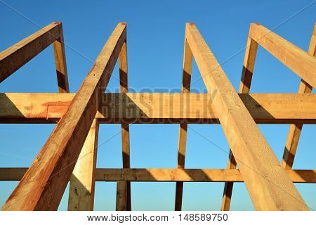 Wooden Roof frame rafters against a blue sky