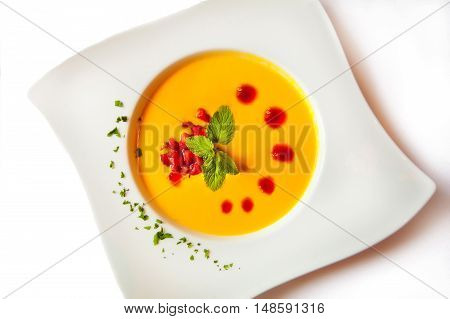 carrot soup on the attractive plate white background