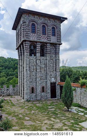 Giginski monastery,  Bulgaria - June 25, 2016:  View of inner  part yard with  bell tower in restored Montenegrin or Giginski monastery  St. St. Cosmas and Damian, mountain  Kitka, Breznik, Pernik region, Bulgaria. Visit in the place circa June 2016.