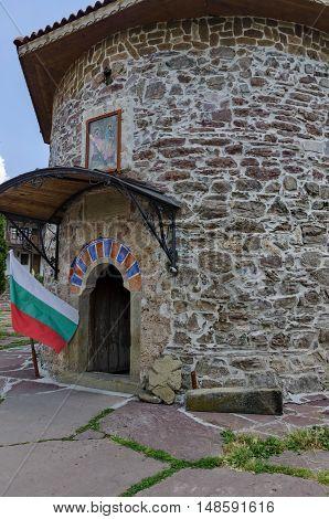 Kyustendil, Bulgaria - June 25, 2016:  View of inner  yard with old medieval church  in restored Montenegrin or Giginski monastery  St. St. Cosmas and Damian, mountain  Kitka, Breznik, Pernik region, Bulgaria. Visit in the place circa June 2016.