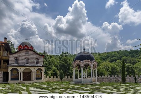 Giginski monastery, Bulgaria - June 25, 2016:  View of inner  part yard with new monastic house, alcove  and new church, in restored Montenegrin or Giginski monastery  St. St. Cosmas and Damian, mountain  Kitka, Breznik, Pernik region, Bulgaria. Visit in