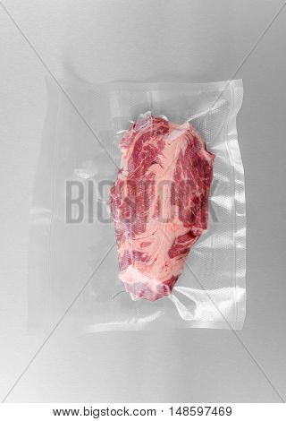 Vacuum sealed fresh Chuck eye steak for sous vide cooking