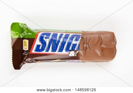 Odessa Ukraine - September 5 2016: Snickers chocolate bar with hazelnuts and peanuts isolated on white background. Snickers bars are produced by Mars Incorporated.