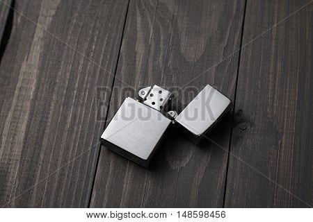 gasoline lighter metal lighter on the wooden background
