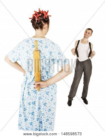Couple Problem. Stereotypical Wife With Rolling Pin And Her Husband