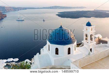View over the churches of Imerovigli, Santorini, at sunset
