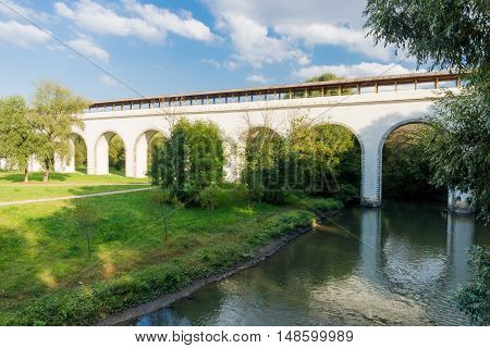 White aqueduct bridge across the small river