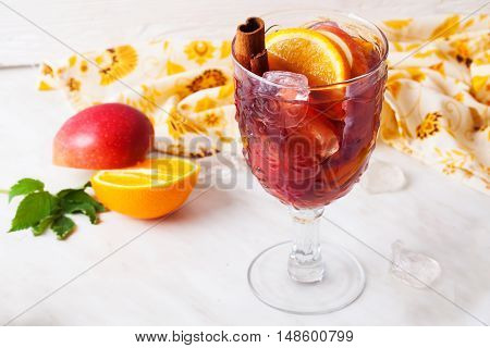 mulled wine apple cinnamon orange chilled ice close-up grog sangria top
