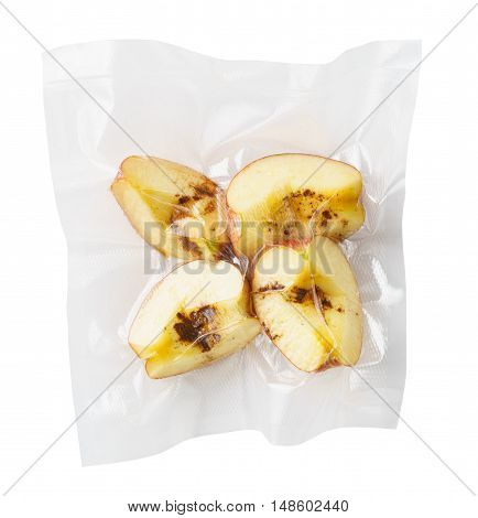 Vacuum sealed fresh apricots with cinnamon for sous vide cooking cutout on white