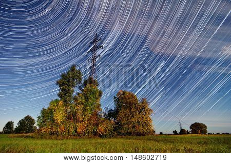 Time lapse of a electricity pylon in front of Startrails