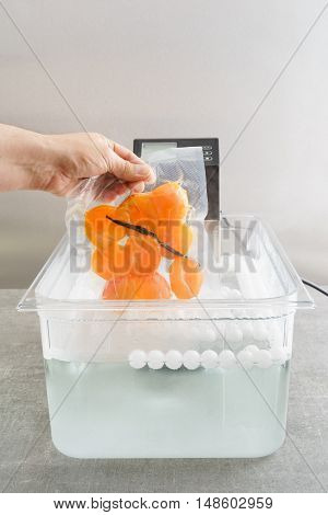 Sous vide cooking of apricots in a sous vide precision immersion cooker with water and water balls