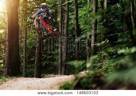 Professional athlete high jump on a mountain bike.