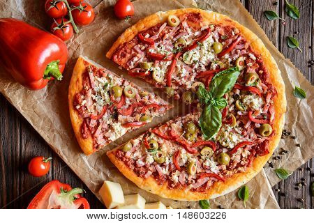 Pizza With Ham, Bacon, Olives, Pepper And Cheese