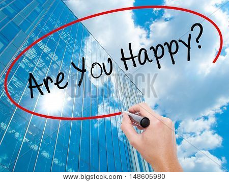 Man Hand Writing Are You Happy? With Black Marker On Visual Screen