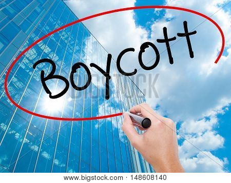 Man Hand Writing Boycott With Black Marker On Visual Screen.