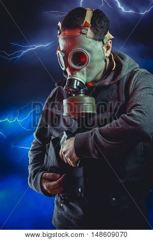 Man with long leather jacket and assault rifle over storm background