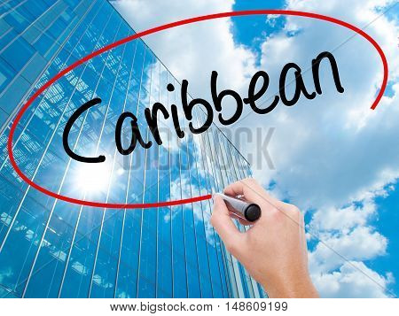 Man Hand Writing Caribbean With Black Marker On Visual Screen