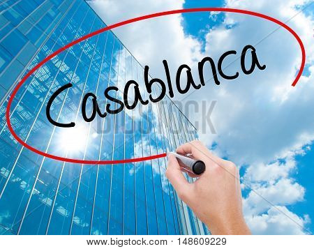Man Hand Writing Casablanca With Black Marker On Visual Screen