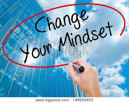 Man Hand Writing Change Your Mindset With Black Marker On Visual Screen.