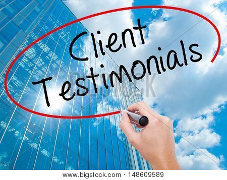 Man Hand Writing Client Testimonials With Black Marker On Visual Screen