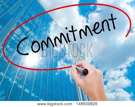 Man Hand Writing Commitment With Black Marker On Visual Screen.
