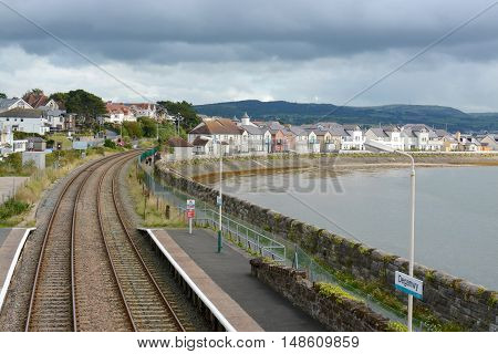 DEGANWY, UK - SEPTEMBER 21, 2016: Deganwy railway station and estuary, photograph taken from railway station bridge, Deganwy, Wales, UK