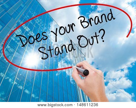 Man Hand Writing Does Your Brand Stand Out? With Black Marker On Visual Screen